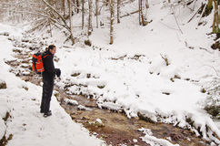 Man hiking near a river Stock Images