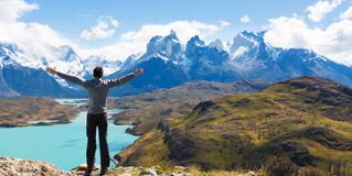 Man hiking in patagonia. Man at mirador condor enjoying hiking and view of cuernos del paine in torres del paine national park, patagonia, chile stock photo