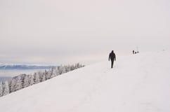 Man hiking on Piatra Mare peak Stock Photos