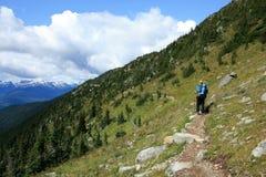 Man Hiking at Piccola Summit. Backpacker traversing Piccola Summit near Whistler, British Columbia, Canada Stock Image