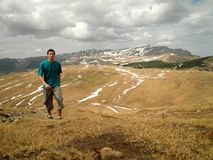 Man Hiking in Plateau. Young man walking in extensive steppes in Romania royalty free stock image
