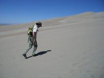 Man hiking in sand dunes Royalty Free Stock Photos