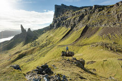 Man hiking through Scottish Highlands. Man hiking through the Scottish Highlands in the Inner Hebrides, Isle of Skye, Scotland stock photo