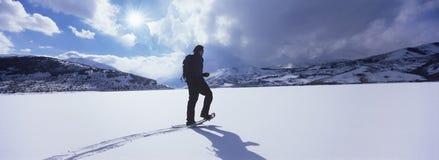 Man Hiking Through Snow Royalty Free Stock Image