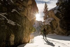 Man Hiking in Snowy Mountain Royalty Free Stock Images