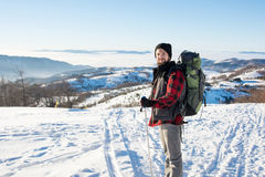Man hiking on the snowy mountain Royalty Free Stock Image