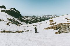 Man hiking in snowy mountains Travel Lifestyle Royalty Free Stock Photos