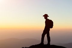 Man hiking success silhouette in mountains Royalty Free Stock Images