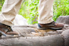 Man hiking on top of a stream Royalty Free Stock Photos