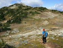 Man Hiking Towards Piccola Summit. A man hiking towards Piccola Summit near Whistler, British Columbia, Canada Royalty Free Stock Photography