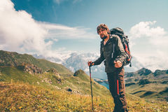 Man hiking Travel Lifestyle concept. Cloudy mountains landscape on background adventure active vacations outdoor stock photography