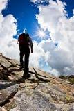 Man hiking up mountain Stock Photo