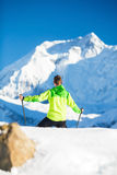 Man hiking in white winter mountains Royalty Free Stock Photography