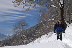 Man hiking in winter Stock Images
