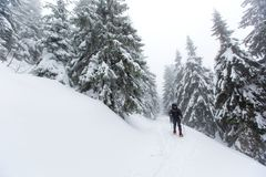 Man hiking in winter mountains before thunderstorm Stock Photography
