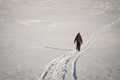 Man hiking in winter on a snow trail