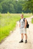 Man hiking into the woods Royalty Free Stock Photo