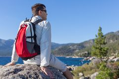 Man hiking. Young healthy man resting at the top of the rock after hiking near lake tahoe, california, usa Stock Photography