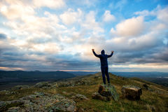 Man on a hill at sunset Royalty Free Stock Photography