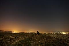 Man on hillside over city