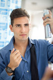 Man himself has makes hairstyle Royalty Free Stock Images
