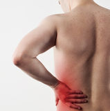Man hip pain. Hip pain on male body. Closeup of person body with painful left side. Concept of physiotherapy and massage Stock Photography