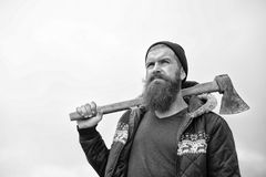 Man hipster or guy with beard and moustache holding axe Royalty Free Stock Photography