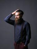 Man hipster tidies hair Royalty Free Stock Photo