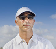 Man in his 40's with a white hat. And sunglasses Stock Photography