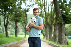 man and his adorable little dog Stock Photo