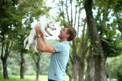 man and his adorable little dog Royalty Free Stock Photos