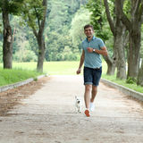 Man and his adorable little dog Stock Images