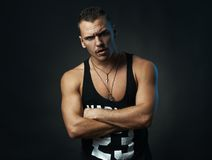 Man with his arms crossed looking incredulously Stock Images