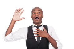 Man with his arms up and looking surprised Stock Photo