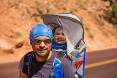 A man with his baby boy are trekking in Zion national park Royalty Free Stock Photos