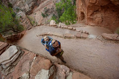 A man with his baby boy are trekking in Zion national park Royalty Free Stock Photo