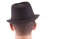 Man on his back with a black hat on Royalty Free Stock Photo