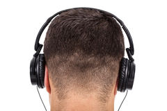 Man on his back with headphones on head Royalty Free Stock Images