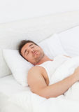 A man in his bed before waking up Royalty Free Stock Photos
