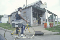Man on his bicycle with his boom box, Stock Photo