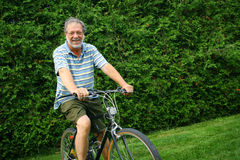 Man on his bike Royalty Free Stock Photography