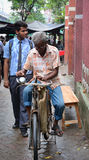 A man with his bike at Old Market in Kolkata, India Royalty Free Stock Photo