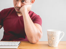 Man and his boring work. Asian man feel sleepy and bored with his office work Stock Image