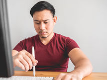 Man and his boring work. Asian man feel sleepy and bored with his office work Royalty Free Stock Photo