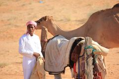 A man and his camel Royalty Free Stock Image