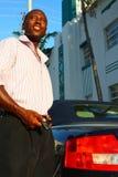 Man and his car Stock Photos