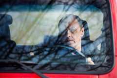 Man in his car behind wheel front view Royalty Free Stock Photo