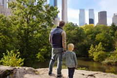 Man and her charming little son admire the views in Central Park, new York stock images