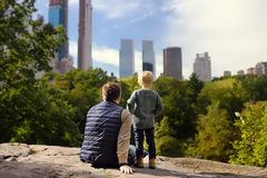 Man and his charming little son admire the views in Central Park, new York royalty free stock photo
