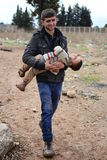 Man with his child illegaly entering Turkey. During Syrian civil war Royalty Free Stock Photography